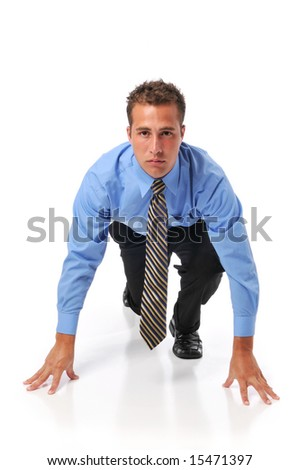 Businessman lined up ready for race in business isolated on a white background - stock photo