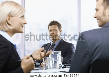 Businessman listening on colleague's explanation at office meeting. - stock photo