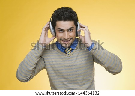 Businessman listening to headphones