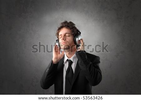Businessman listening to music - stock photo