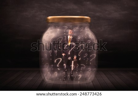 Businessman locked into a jar with question marks concept on background - stock photo