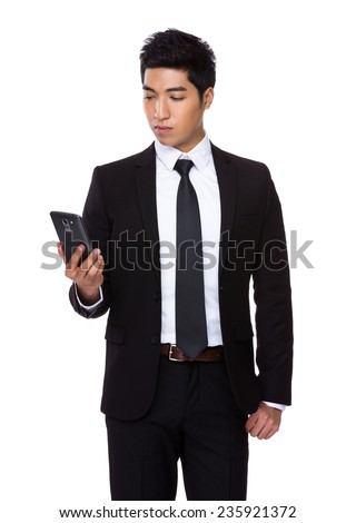 Businessman look at cellphone