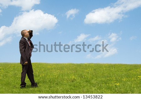 businessman look on cloudy sky - stock photo