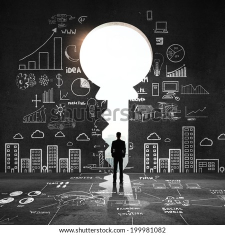 businessman looking an big key and drawing concept - stock photo
