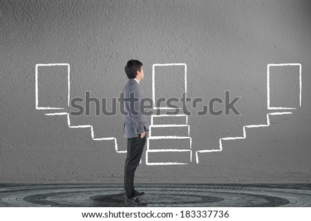 Businessman looking and drawing stairway for success solution concept