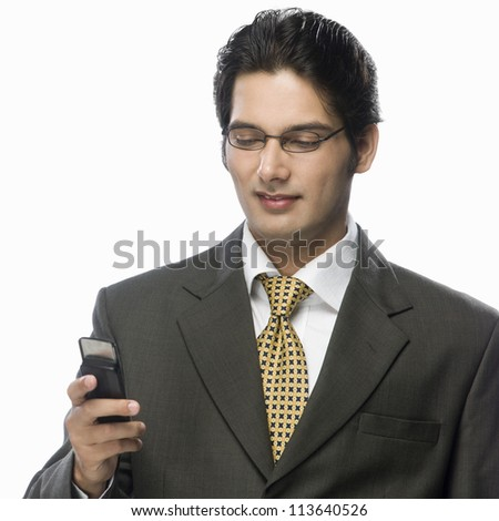 Businessman looking at a mobile phone