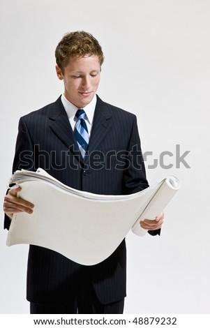 Businessman looking at blueprints - stock photo
