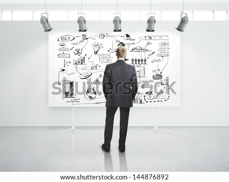 businessman looking at business strategy - stock photo