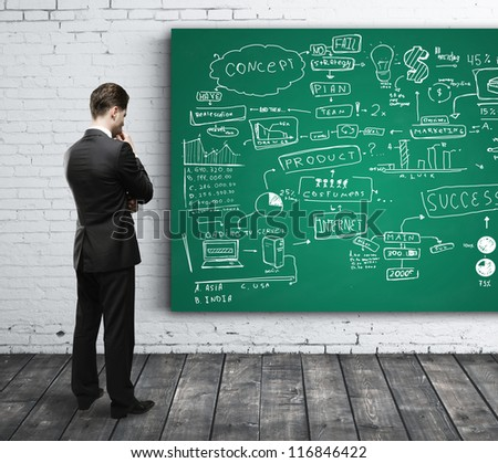 businessman looking at business strategy on board - stock photo