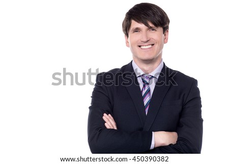 Businessman looking at camera with crossed arms.