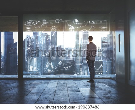 Businessman looking at city through window with drawing business strategy - stock photo