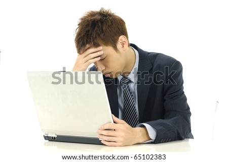 businessman looking at computer in desperation