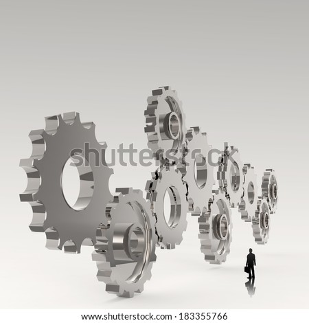 businessman looking at  3d cog  gear to success as concept  - stock photo