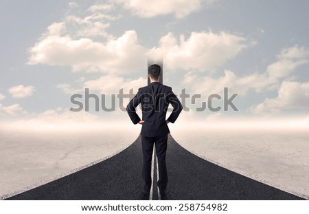 Businessman looking at 3d road that goes up in the sky concept - stock photo