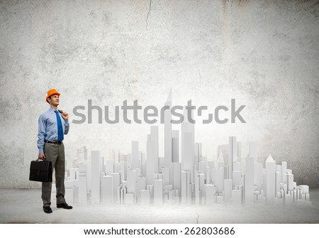 Businessman looking at digital construction project of modern city - stock photo