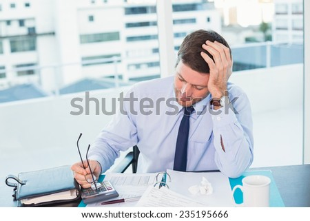 Businessman looking at documents in his office