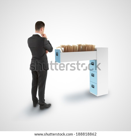 businessman looking at file cabinet with  documents - stock photo