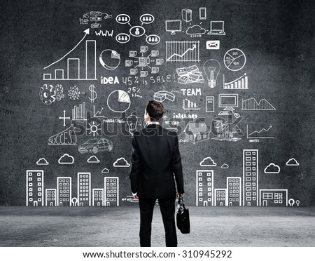 businessman looking at global business plan - stock photo