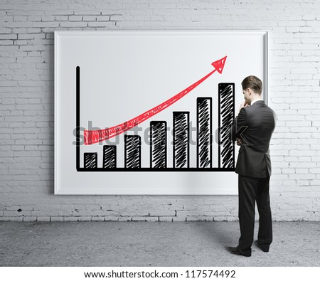 businessman looking at growth chart on desk - stock photo