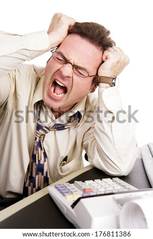 Businessman looking at his finances and screaming.  White background - stock photo
