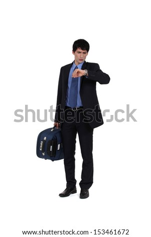 Businessman looking at his watch - stock photo