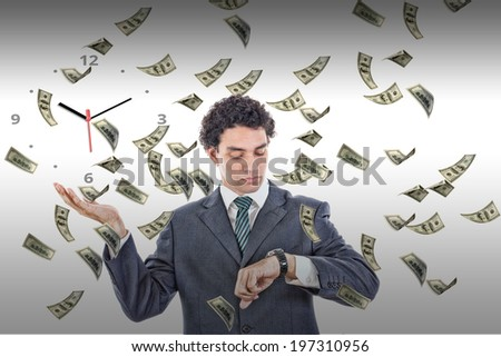 Businessman looking at his watch with money rain around him, rich man in suit measuring time on clock surrounded by flying dollars