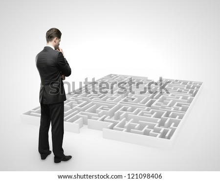 businessman looking at labyrinth on white background - stock photo