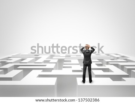 Businessman looking at the maze - stock photo