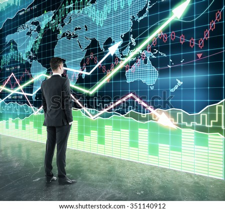 Businessman looking at the scoreboard with business chart - stock photo