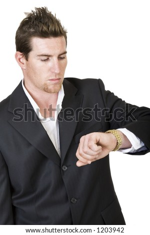 Businessman looking at the time on his watch