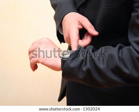 businessman looking at watch - stock photo