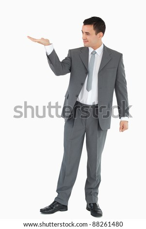 Businessman looking at what he is presenting against a white background