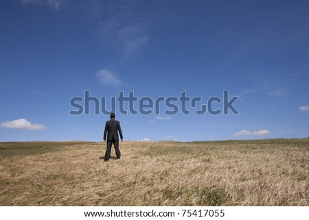 businessman looking away at the field