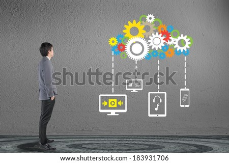 Businessman looking cloud computing network with gear and engine concept
