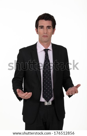 Businessman looking confused - stock photo