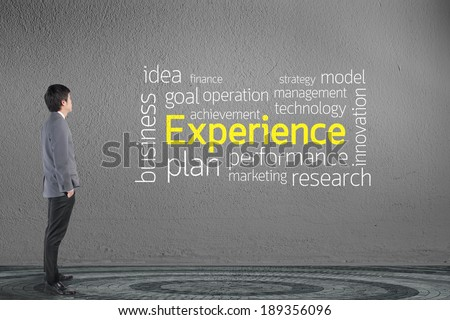 Businessman looking Experience text wording in cloud concept - stock photo