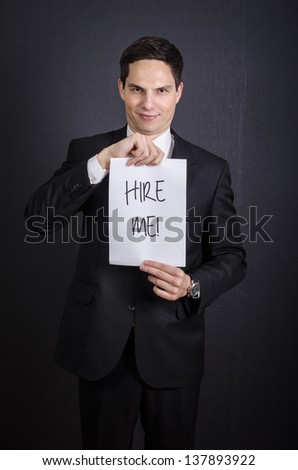 "Businessman Looking for a Job, Man Holding ""Hire Me!"""