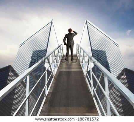 Businessman looking for new business over a stairs - stock photo