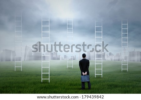 Businessman looking for new job opportunities on the city - stock photo