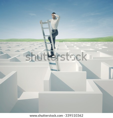 Businessman looking for the solution of the maze - stock photo
