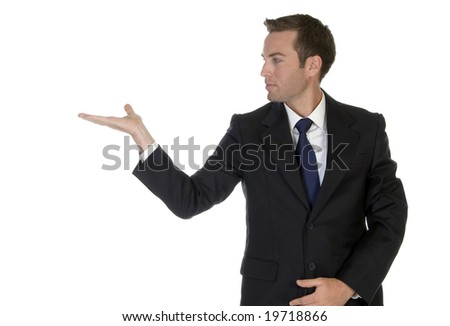 businessman looking his palm on an isolated background - stock photo