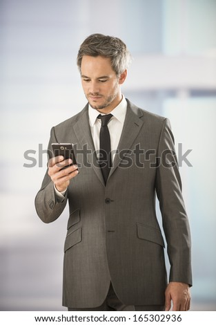 businessman looking his smartphone - stock photo