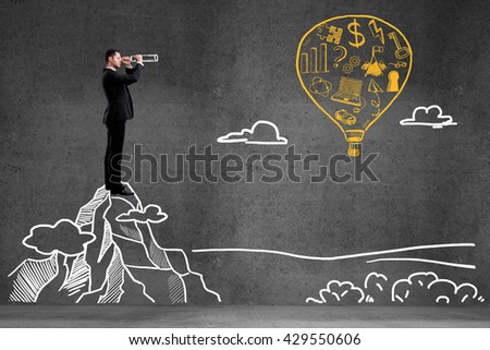 businessman looking on balloon with drawing  business symbol. success concept - stock photo