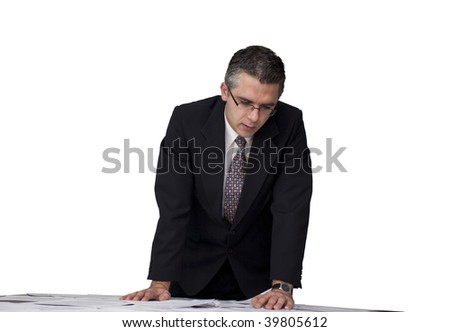Businessman looking over the paperwork (white background) - stock photo
