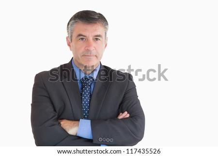 Businessman looking serious while having arms crossed