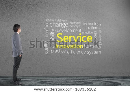Businessman looking Service text wording in cloud concept - stock photo