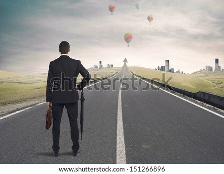 Businessman looking the road to success - stock photo