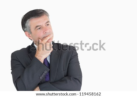 Businessman looking thoughtful while holding his head - stock photo