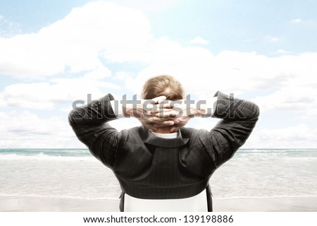 businessman looking to beautiful sea - stock photo