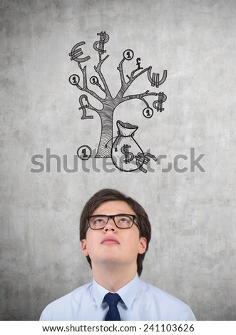 businessman looking to drawing money tree - stock photo